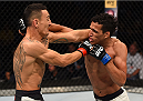 SASKATOON, SK - AUGUST 23:  (R-L) Charles Oliveira of Brazil punches Max Holloway of the United States in their featherweight bout during the UFC event at the SaskTel Centre on August 23, 2015 in Saskatoon, Saskatchewan, Canada. (Photo by Jeff Bottari/Zuffa LLC/Zuffa LLC via Getty Images)