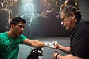 LAS VEGAS, NV - MARCH 27:  Erick Montano gets his hands wrapped before facing Marco Olano during the filming of The Ultimate Fighter Latin America: Team Gastelum vs Team Escudero  on March 27, 2015 in Las Vegas, Nevada. (Photo by Brandon Magnus/Zuffa LLC/Zuffa LLC via Getty Images) *** Local Caption ***