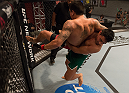 LAS VEGAS, NV - MARCH 27:  (R-L) Erick Montano takes down Marco Olano during the filming of The Ultimate Fighter Latin America: Team Gastelum vs Team Escudero  on March 27, 2015 in Las Vegas, Nevada. (Photo by Brandon Magnus/Zuffa LLC/Zuffa LLC via Getty Images) *** Local Caption ***