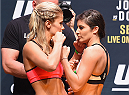 LAS VEGAS, NV - SEPTEMBER 04:  (L-R) Paige VanZant  and Alex Chambers face off during the UFC 191 weigh-in inside MGM Grand Garden Arena on September 4, 2015 in Las Vegas, Nevada.  (Photo by Josh Hedges/Zuffa LLC/Zuffa LLC via Getty Images)