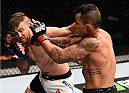 LAS VEGAS, NV - SEPTEMBER 05: (L-R) Nazareno Malegarie punches Joaquim Silva in their lightweight bout during the UFC 191 event inside MGM Grand Garden Arena on September 5, 2015 in Las Vegas, Nevada.  (Photo by Jeff Bottari/Zuffa LLC/Zuffa LLC via Getty Images) *** Local Caption *** Joaquim Silva; Nazareno Malegarie