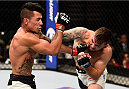 LAS VEGAS, NV - SEPTEMBER 05: (R-L) Nazareno Malegarie punches Joaquim Silva in their lightweight bout during the UFC 191 event inside MGM Grand Garden Arena on September 5, 2015 in Las Vegas, Nevada.  (Photo by Jeff Bottari/Zuffa LLC/Zuffa LLC via Getty Images) *** Local Caption *** Joaquim Silva; Nazareno Malegarie