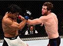 LAS VEGAS, NV - SEPTEMBER 05: (R-L) Clay Collard punches Tiago Trator in their featherweight bout during the UFC 191 event inside MGM Grand Garden Arena on September 5, 2015 in Las Vegas, Nevada.  (Photo by Jeff Bottari/Zuffa LLC/Zuffa LLC via Getty Images) *** Local Caption *** Clay Collard; Tiago Trator