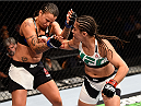 LAS VEGAS, NV - SEPTEMBER 05: (R-L) Jessica Andrade punches Raquel Pennington  in their women's bantamweight bout during the UFC 191 event inside MGM Grand Garden Arena on September 5, 2015 in Las Vegas, Nevada.  (Photo by Jeff Bottari/Zuffa LLC/Zuffa LLC via Getty Images) *** Local Caption *** Jessica Andrade; Raquel Pennington