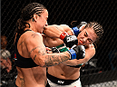 LAS VEGAS, NV - SEPTEMBER 05: (L-R) Raquel Pennington punches Jessica Andrade in their women's bantamweight bout during the UFC 191 event inside MGM Grand Garden Arena on September 5, 2015 in Las Vegas, Nevada.  (Photo by Jeff Bottari/Zuffa LLC/Zuffa LLC via Getty Images) *** Local Caption *** Jessica Andrade; Raquel Pennington