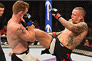 LAS VEGAS, NV - SEPTEMBER 05: (R-L) Ross Pearson kicks Paul Felder in their lightweight bout during the UFC 191 event inside MGM Grand Garden Arena on September 5, 2015 in Las Vegas, Nevada.  (Photo by Josh Hedges/Zuffa LLC/Zuffa LLC via Getty Images) *** Local Caption *** Ross Pearson; Paul Felder
