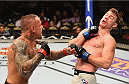 LAS VEGAS, NV - SEPTEMBER 05: (L-R) Ross Pearson punches Paul Felder in their lightweight bout during the UFC 191 event inside MGM Grand Garden Arena on September 5, 2015 in Las Vegas, Nevada.  (Photo by Josh Hedges/Zuffa LLC/Zuffa LLC via Getty Images) *** Local Caption *** Ross Pearson; Paul Felder