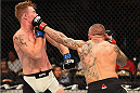 LAS VEGAS, NV - SEPTEMBER 05: (R-L) Ross Pearson punches Paul Felder in their lightweight bout during the UFC 191 event inside MGM Grand Garden Arena on September 5, 2015 in Las Vegas, Nevada.  (Photo by Josh Hedges/Zuffa LLC/Zuffa LLC via Getty Images) *** Local Caption *** Ross Pearson; Paul Felder