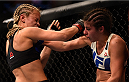 LAS VEGAS, NV - SEPTEMBER 05: (R-L) Alex Chambers punches Paige VanZant in their women's strawweight bout during the UFC 191 event inside MGM Grand Garden Arena on September 5, 2015 in Las Vegas, Nevada.  (Photo by Jeff Bottari/Zuffa LLC/Zuffa LLC via Getty Images) *** Local Caption *** Paige VanZant; Alex Chambers