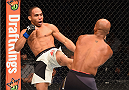 LAS VEGAS, NV - SEPTEMBER 05: (L-R) John Dodson kicks Demetrious Johnson in their flyweight championship bout during the UFC 191 event inside MGM Grand Garden Arena on September 5, 2015 in Las Vegas, Nevada.  (Photo by Josh Hedges/Zuffa LLC/Zuffa LLC via Getty Images) *** Local Caption *** Demetrious Johnson; John Dodson