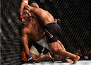 LAS VEGAS, NV - SEPTEMBER 05: (R-L) Demetrious Johnson wrestles with John Dodson in their flyweight championship bout during the UFC 191 event inside MGM Grand Garden Arena on September 5, 2015 in Las Vegas, Nevada.  (Photo by Jeff Bottari/Zuffa LLC/Zuffa LLC via Getty Images) *** Local Caption *** Demetrious Johnson; John Dodson