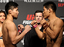 SAITAMA, JAPAN - SEPTEMBER 25: (L and R) Keita Nakamura and Li Jingliang during the UFC weigh-in at the Saitama Super Arena on September 25, 2015 in Saitama, Japan. (Photo by Mitch Viquez/Zuffa LLC/Zuffa LLC via Getty Images)