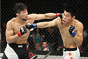 SAITAMA, JAPAN - SEPTEMBER 27: Keita Nakamura of Japan punches Li Jingliang of China in their welterweight bout during the UFC event at the Saitama Super Arena on September 27, 2015 in Saitama, Japan. (Photo by Mitch Viquez/Zuffa LLC/Zuffa LLC via Getty Images)