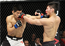 SAITAMA, JAPAN - SEPTEMBER 27: (From L to R) Li Jingliang of China and Keita Nakamura of Japan look for openings in their welterweight bout during the UFC event at the Saitama Super Arena on September 27, 2015 in Saitama, Japan. (Photo by Mitch Viquez/Zuffa LLC/Zuffa LLC via Getty Images)