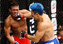 SAITAMA, JAPAN - SEPTEMBER 27: (From L to R) Teruto Ishihara of Japan and Mizuto Hirota of Japan exchange punches in their featherweight bout during the UFC event at the Saitama Super Arena on September 27, 2015 in Saitama, Japan. (Photo by Mitch Viquez/Zuffa LLC/Zuffa LLC via Getty Images)