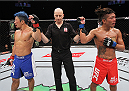 SAITAMA, JAPAN - SEPTEMBER 27: (From L to R) Mizuto Hirota of Japan and Teruto Ishihara of Japan react after hearing their featherweight bout  was a majority draw during the UFC event at the Saitama Super Arena on September 27, 2015 in Saitama, Japan. (Photo by Mitch Viquez/Zuffa LLC/Zuffa LLC via Getty Images)
