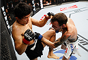 SAITAMA, JAPAN - SEPTEMBER 27:  Takeya Mizugaki of Japan throws a knee on George Roop of the United States of America in their bantamweight bout during the UFC event at the Saitama Super Arena on September 27, 2015 in Saitama, Japan. (Photo by Mitch Viquez/Zuffa LLC/Zuffa LLC via Getty Images)