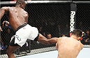 SAITAMA, JAPAN - SEPTEMBER 27: Uriah Hall of Jamaica lands a back kick to drop his opponent, Gegard Mousaasi of Iran in their middleweight bout during the UFC event at the Saitama Super Arena on September 27, 2015 in Saitama, Japan. (Photo by Mitch Viquez/Zuffa LLC/Zuffa LLC via Getty Images)