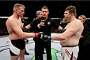 SAITAMA, JAPAN - SEPTEMBER 27: (From L to R) Josh Barnett of the United States of America and Roy Nelson of the United States of America touch gloves in their heavyweight bout during the UFC event at the Saitama Super Arena on September 27, 2015 in Saitama, Japan. (Photo by Mitch Viquez/Zuffa LLC/Zuffa LLC via Getty Images)