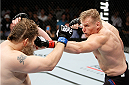 SAITAMA, JAPAN - SEPTEMBER 27: Josh Barnett of the United States of America throws a punch at Roy Nelson of the United States of America in their heavyweight bout during the UFC event at the Saitama Super Arena on September 27, 2015 in Saitama, Japan. (Photo by Mitch Viquez/Zuffa LLC/Zuffa LLC via Getty Images)