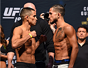 HOUSTON, TX - OCTOBER 02:  Chris Cariaso and Sergio Pettis face off during the UFC 192 weigh-in at the Toyota Center on October 2, 2015 in Houston, Texas. (Photo by Josh Hedges/Zuffa LLC/Zuffa LLC via Getty Images)