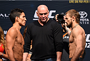 HOUSTON, TX - OCTOBER 02:  (L-R) Joseph Benavidez and Ali Bagautinov face off during the UFC 192 weigh-in at the Toyota Center on October 2, 2015 in Houston, Texas. (Photo by Josh Hedges/Zuffa LLC/Zuffa LLC via Getty Images)