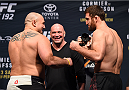 HOUSTON, TX - OCTOBER 02:  (L-R) Shawn Jordan and Ruslan Magomedov face off during the UFC 192 weigh-in at the Toyota Center on October 2, 2015 in Houston, Texas. (Photo by Josh Hedges/Zuffa LLC/Zuffa LLC via Getty Images)