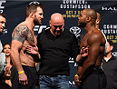 HOUSTON, TX - OCTOBER 02:  (L-R) Ryan Bader and Rashad Evans face off steps on the scale during the UFC 192 weigh-in at the Toyota Center on October 2, 2015 in Houston, Texas. (Photo by Josh Hedges/Zuffa LLC/Zuffa LLC via Getty Images)