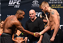 HOUSTON, TX - OCTOBER 02:  UFC light heavyweight champion Daniel Cormier and Alexander Gustafsson shake hands during the UFC 192 weigh-in at the Toyota Center on October 2, 2015 in Houston, Texas. (Photo by Josh Hedges/Zuffa LLC/Zuffa LLC via Getty Images)