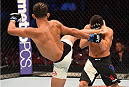 HOUSTON, TX - OCTOBER 03:  (L-R) Sergio Pettis kicks Chris Cariaso in their flyweight bout during the UFC 192 event at the Toyota Center on October 3, 2015 in Houston, Texas. (Photo by Josh Hedges/Zuffa LLC/Zuffa LLC via Getty Images)