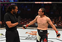 HOUSTON, TX - OCTOBER 03:  Francisco Trevino argues with referee Herb Dean after his lightweight bout against Sage Northcutt during the UFC 192 event at the Toyota Center on October 3, 2015 in Houston, Texas. (Photo by Josh Hedges/Zuffa LLC/Zuffa LLC via Getty Images)