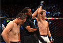 HOUSTON, TX - OCTOBER 03:  (R-L) Sage Northcutt celebrates his victory over Francisco Trevino in their lightweight bout during the UFC 192 event at the Toyota Center on October 3, 2015 in Houston, Texas. (Photo by Josh Hedges/Zuffa LLC/Zuffa LLC via Getty Images)