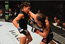 HOUSTON, TX - OCTOBER 03:  (L-R) Julianna Pena exchanges punches with Jessica Eye in their women's bantamweight bout during the UFC 192 event at the Toyota Center on October 3, 2015 in Houston, Texas. (Photo by Josh Hedges/Zuffa LLC/Zuffa LLC via Getty Images)