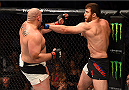 HOUSTON, TX - OCTOBER 03:  (R-L) Ruslan Magomedov punches Shawn Jordan in their heavyweight bout during the UFC 192 event at the Toyota Center on October 3, 2015 in Houston, Texas. (Photo by Josh Hedges/Zuffa LLC/Zuffa LLC via Getty Images)