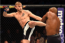 HOUSTON, TX - OCTOBER 03:  (L-R) Alexander Gustafsson kicks Daniel Cormier in their UFC light heavyweight championship bout during the UFC 192 event at the Toyota Center on October 3, 2015 in Houston, Texas. (Photo by Josh Hedges/Zuffa LLC/Zuffa LLC via Getty Images)