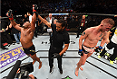 HOUSTON, TX - OCTOBER 03:  (L-R) Daniel Cormier celebrates his victory over Alexander Gustafsson in their UFC light heavyweight championship bout during the UFC 192 event at the Toyota Center on October 3, 2015 in Houston, Texas. (Photo by Josh Hedges/Zuffa LLC/Zuffa LLC via Getty Images)