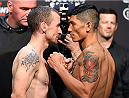 DUBLIN, IRELAND - OCTOBER 23:  (L-R) Opponents Neil Seery of Ireland and Jon Delos Reyes of Guam face off during the UFC weigh-in at 3Arena on October 23, 2015 in Dublin, Ireland. (Photo by Josh Hedges/Zuffa LLC/Zuffa LLC via Getty Images)