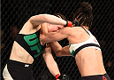 DUBLIN, IRELAND - OCTOBER 24:  (L-R) Aisling Daly punches Ericka Almeida in their women's strawweight fight during the UFC event at 3Arena on October 24, 2015 in Dublin, Ireland. (Photo by Josh Hedges/Zuffa LLC/Zuffa LLC via Getty Images)