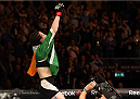 DUBLIN, IRELAND - OCTOBER 24:  Aisling Daly raises her hands in the air after facing Ericka Almeida in their women's strawweight fight during the UFC event at 3Arena on October 24, 2015 in Dublin, Ireland. (Photo by Josh Hedges/Zuffa LLC/Zuffa LLC via Getty Images)