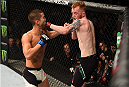 DUBLIN, IRELAND - OCTOBER 24:  (R-L) Paddy Holohan exchanges punches with Louis Smolka in their flyweight fight during the UFC event at 3Arena on October 24, 2015 in Dublin, Ireland. (Photo by Josh Hedges/Zuffa LLC/Zuffa LLC via Getty Images)