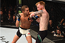 DUBLIN, IRELAND - OCTOBER 24:  (L-R) Louis Smolka elbows Paddy Holohan in their flyweight fight during the UFC event at 3Arena on October 24, 2015 in Dublin, Ireland. (Photo by Josh Hedges/Zuffa LLC/Zuffa LLC via Getty Images)