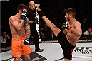 SAO PAULO, BRAZIL - NOVEMBER 07: Bruno Korea of Brazil kicks Matheus Nicolau of Brazil in their bantamweight bout during the UFC Fight Night Belfort v Henderson at Ibirapuera Gymnasium on November 7, 2015 in Sao Paulo, Brazil. on November 7, 2015 in Sao Paulo, Brazil. (Photo by Buda Mendes/Zuffa LLC/Zuffa LLC via Getty Images)