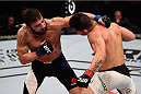 SAO PAULO, BRAZIL - NOVEMBER 07: Jimmie Rivera of the United States punches Pedro Munhoz of Brazil in their bantamweight bout during the UFC Fight Night Belfort v Henderson at Ibirapuera Gymnasium on November 7, 2015 in Sao Paulo, Brazil. (Photo by Buda Mendes/Zuffa LLC/Zuffa LLC via Getty Images)