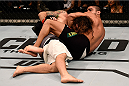 SAO PAULO, BRAZIL - NOVEMBER 07: Thiago Tavares of Brazil submits Clay Guida of the United States in their featherweight bout during the UFC Fight Night Belfort v Henderson at Ibirapuera Gymnasium on November 7, 2015 in Sao Paulo, Brazil. (Photo by Buda Mendes/Zuffa LLC/Zuffa LLC via Getty Images)