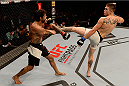 SAO PAULO, BRAZIL - NOVEMBER 07:  Johnny Case of the United States kicks Yan Cabral of Brazil in their lightweight bout during the UFC Fight Night Belfort v Henderson at Ibirapuera Gymnasium on November 7, 2015 in Sao Paulo, Brazil.  (Photo by Buda Mendes/Zuffa LLC/Zuffa LLC via Getty Images)