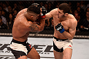 SAO PAULO, BRAZIL - NOVEMBER 07:  Rashid Magomedov of Russia punches Gilbert Burns of Brazil in their lightweight bout during the UFC Fight Night Belfort v Henderson at Ibirapuera Gymnasium on November 7, 2015 in Sao Paulo, Brazil.  (Photo by Buda Mendes/Zuffa LLC/Zuffa LLC via Getty Images)