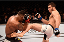 SAO PAULO, BRAZIL - NOVEMBER 07:  Rashid Magomedov of Russia kicks Gilbert Burns of Brazil in their lightweight bout during the UFC Fight Night Belfort v Henderson at Ibirapuera Gymnasium on November 7, 2015 in Sao Paulo, Brazil.  (Photo by Buda Mendes/Zuffa LLC/Zuffa LLC via Getty Images)