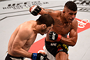 SAO PAULO, BRAZIL - NOVEMBER 07:  Gilbert Burns of Brazil punches Rashid Magomedov of Russia in their lightweight bout during the UFC Fight Night Belfort v Henderson at Ibirapuera Gymnasium on November 7, 2015 in Sao Paulo, Brazil.  (Photo by Buda Mendes/Zuffa LLC/Zuffa LLC via Getty Images)