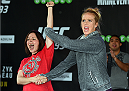 MELBOURNE, AUSTRALIA - NOVEMBER 12:  Holly Holm of the United States brings a fan on stage to help with her open workout for fans and media at Federation Square on November 12, 2015 in Melbourne, Australia. (Photo by Josh Hedges/Zuffa LLC/Zuffa LLC via Getty Images)