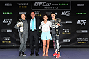 MELBOURNE, AUSTRALIA - NOVEMBER 12:  2015 Melbourne Cup champion jockey Michelle Payne (2R) and Victoria's Minister of Sport John Eren (2L) pose with UFC women's bantamweight champion Ronda Rousey (L) of the United States and UFC women's strawweight champion Joanna Jedrzejczyk (R) of Poland on stage during the UFC 193 open workouts at Federation Square on November 12, 2015 in Melbourne, Australia. (Photo by Josh Hedges/Zuffa LLC/Zuffa LLC via Getty Images)